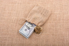 Bundle of US dollar and a heart shape Royalty Free Stock Image