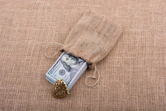 Bundle of US dollar and a heart shape Royalty Free Stock Photography