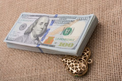 Bundle of US dollar and a heart shape Royalty Free Stock Photos
