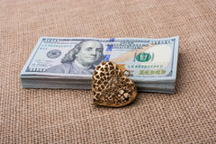 Bundle of US dollar and a heart shape Royalty Free Stock Photo