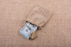 Bundle of US dollar and a heart shape Stock Photography