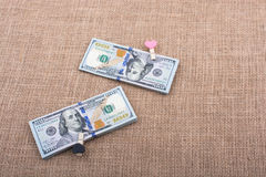 Bundle of US dollar and a heart shape Stock Images
