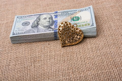 Bundle of US dollar and a heart shape Stock Image