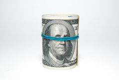 Bundle of US dollars banknotes on over white Stock Photos