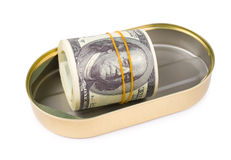 Bundle of US dollars in can. A rolled bundle of US 100 dollars bills in an oval can, clipping path Royalty Free Stock Photos