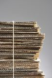 Bundle of waste cardboard tied with string close-up Royalty Free Stock Photos