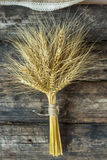 Bundle of wheat. On a old wooden background Royalty Free Stock Images