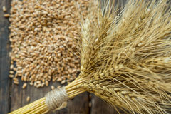 Bundle of wheat and wheat beans. On a old wooden background Royalty Free Stock Photos