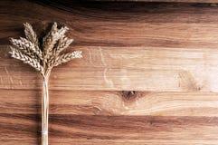 Bundle of wheat on wooden background. Horizontal image Stock Photo