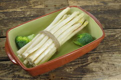 Bundle of white asparagus and   broccoli Stock Photos