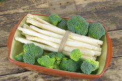 Bundle of white asparagus and   broccoli Royalty Free Stock Photo