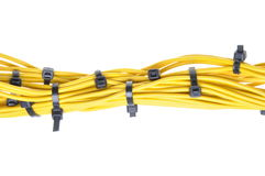 Bundle of yellow cables with black cable ties Royalty Free Stock Images