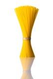 Bundle Yellow Spaghetti Pasta on White Background royalty free stock photos