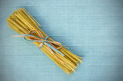 Bundled Linguine on Blue Royalty Free Stock Photos