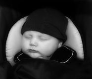 Bundled up and sleep. A beautiful baby boy is bundled up and asleep. Ready to go royalty free stock photos