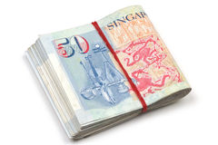 A bundled up stack of singapore dollars. Singapore dollar fifty notes bundled up by rubber band isolated in white background royalty free stock photo