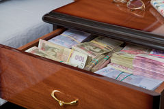 Bundles of banknotes in bedside table Royalty Free Stock Photos