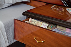 Bundles of banknotes in bedside table Stock Photos