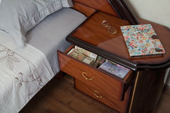 Bundles of banknotes in bedside table Royalty Free Stock Image