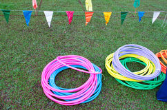 Bundles of colorful Hula Hoop on grass. Kid playground items such hula hoops on the ground Stock Photography