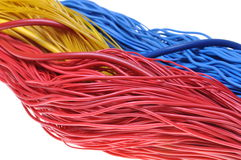 Bundles of colorful network cables. Isolated on white background Stock Images