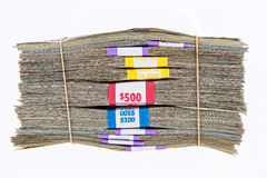 Bundles of different denomination dollar bills. Bank bundles of different denomination dollar bills stacked on top of each other and secured with two rubber Royalty Free Stock Photos