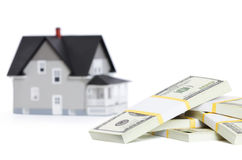 Bundles of dollars in front of house Stock Photo
