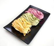 Bundles of dried ribbon color  pasta Royalty Free Stock Images