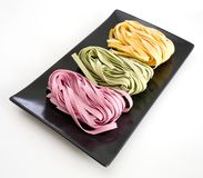 Bundles of dried ribbon color  pasta Stock Photo