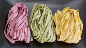 Bundles of dried ribbon color  pasta Royalty Free Stock Photo