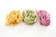 Bundles of dried ribbon color  pasta Stock Photo