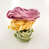Bundles of dried ribbon color  pasta Royalty Free Stock Photo