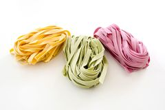 Bundles of dried ribbon color  pasta Stock Photos