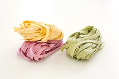 Bundles of dried ribbon color  pasta Stock Photography
