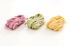 Bundles of dried ribbon color  pasta Stock Images
