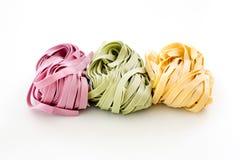 Bundles of dried ribbon color  pasta Royalty Free Stock Image