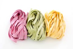 Bundles of dried ribbon color  pasta Stock Image