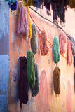 Bundles of dyed wool drying. In the souks of Marrakech Royalty Free Stock Photos