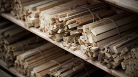 Bundles of firewood. Shelves with bundles of firewood tied with string Stock Photo