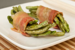 Bundles of green beans wrapped in bacon Royalty Free Stock Photography