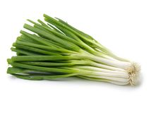 Bundles of green onions. Isolated on a white background Stock Image