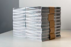 Bundles of newly printed catalogues in a stack