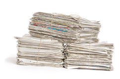 Bundles of newspapers Stock Images