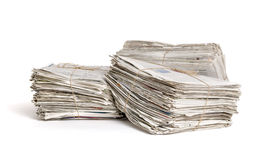 Bundles of newspapers on a white background Stock Photo