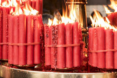 Bundles of Red Prayer Candles Royalty Free Stock Photography