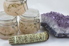Bundles of Sage with amethyst and jars of beauty product. White background Royalty Free Stock Photo
