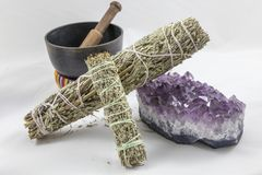 Bundles of Sage with a beautiful Amethyst Crystal and singing bowl. Bundles of Sage with a beautiful Purple Amethyst Crystal and singing bowl Stock Photo
