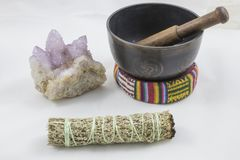 Bundles of Sage with beautiful Spirit Quartz Crystal and a singing bowl.  Stock Images