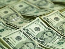 Bundles of U.S. Five Dollar Bills. Bundles of U.S. Five Dollar bill laid out as a background Royalty Free Stock Photos