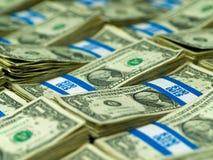 Bundles of U.S. One Dollar Bills. Hundred dollar bundles of U.S. One Dollar bill laid out as a background Stock Image
